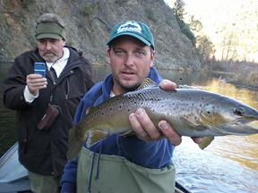 "Johns nice Trinity River Brown (Greg ""Hecky"" holding fish)"
